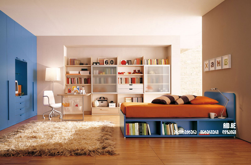cool-kids-bedroom-design-with-blue-platform-bed-and-brown-bedding-near-wide-beige-bookshelves-also-desk-with-white-swivel-chair